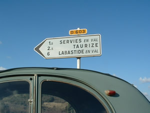 signpost pointing to the three gites in Servies en Val, Aude.